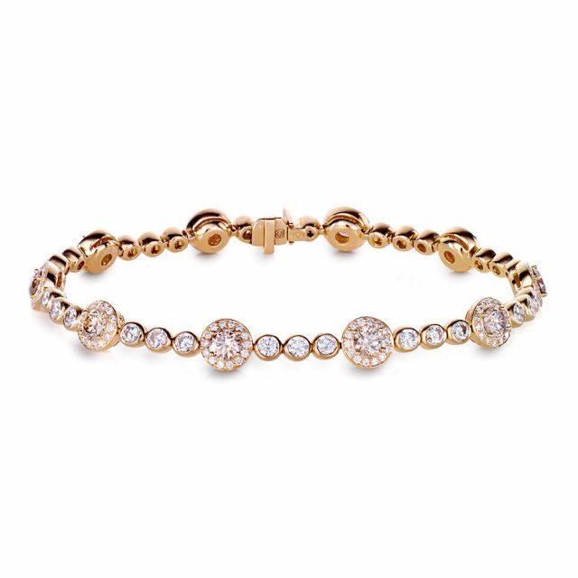 Exclusive armbånd i roségull med fargeløse og champagnefargede diamanter